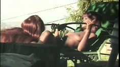 Two chocolate lesbians driving each other's twats to climax by the pool